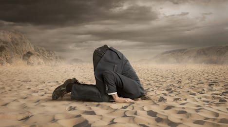 A C-Level Executive hiding head in the sand thinking it will help to avoid program failure